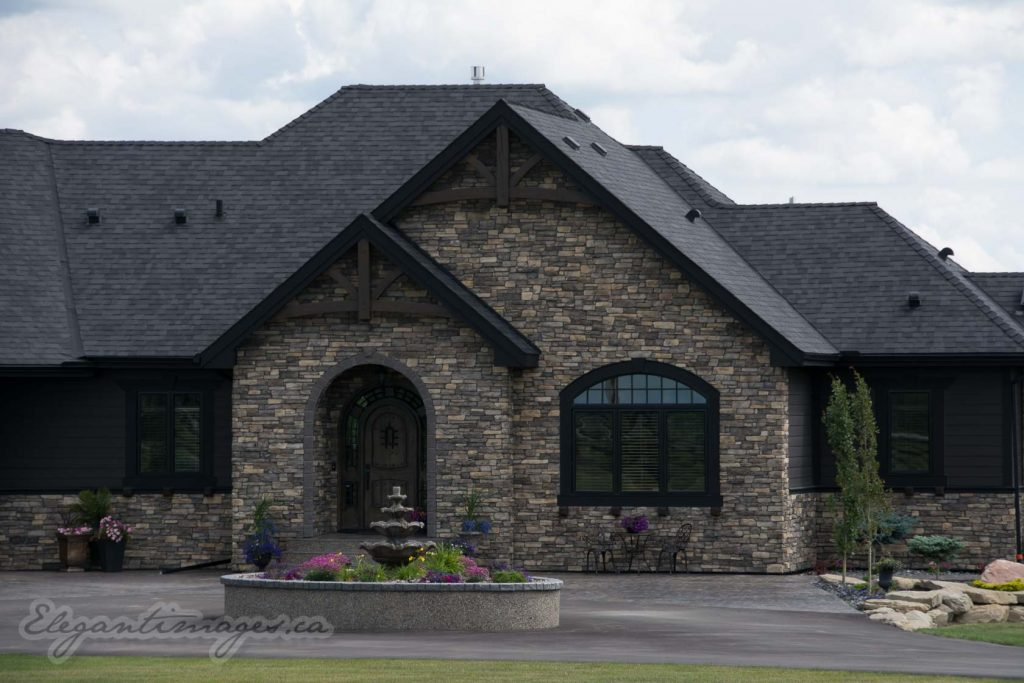 Black Hardie house with rock viklund contracting Carstairs