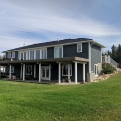 Iron Grey James Hardie Siding on Home West of Cremona